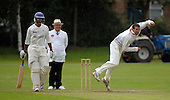 Clydesdale V West of Scotland, Scottish National Cricket League, Premier Division, at Titwood - in a rain affected match West Pro Andrew Ellis bowls past his Clydesdale counterpart Kamran Sajjid and umpire Jeff Meeton to take the wicket of 'Dale's Gerg Williamson (not in pic) - Picture by Donald MacLeod 18.07.09