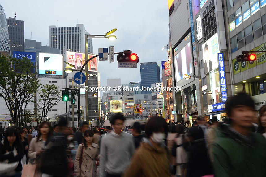 People at crossing by JR shinjuku station in Shinjuku, Tokyo