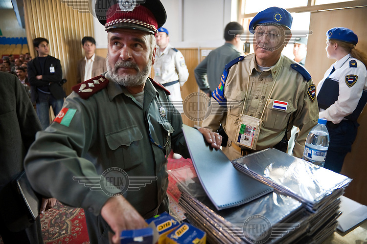 A Dutch representative (right) from EUPOL (European Union Police Mission in Afghanistan) at a conference to train Afghan police in Kabul.