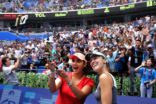 03.10.2015. Wuhan, Hubei Province, China.  Martina Hingis(R) of Switzerland and Sania Mirza of India pose for selfie during the final match of womens doubles against Irina-Camelia Begu and Monica Niculescu of Romania at 2015 WTA Tennis Damen Wuhan Open Tennis Tournament in Wuhan, capital of central Chinas Hubei Province, Oct. 3, 2015. Martina Hingis and Sania Mirza won 2-0 and claimed the title.