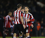 Chris Basham of Sheffield Utd celebrates with Billy Sharp of Sheffield Utd during the English League One match at the Bramall Lane Stadium, Sheffield. Picture date: November 22nd, 2016. Pic Simon Bellis/Sportimage