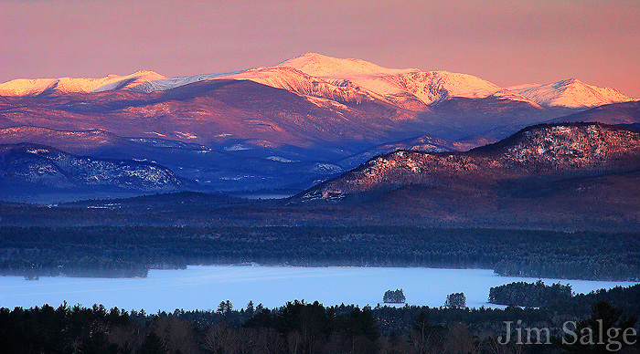 First light hits Mount Washington, the highest peak in New England on a frigid clear morning.