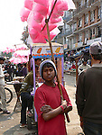 A young man sells fairy floss in the streets of Patan, Nepal.