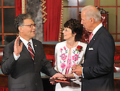 Washington, DC - July 7, 2009 -- United States Senator Al Franken (Democrat of Minnesota) takes the oath of office as he participates in a mock swearing-in ceremony in the Old Senate Chamber in the U.S. Capitol in Washington, D.C. on Tuesday, July 7, 2009.  From left to right: Senator Franken, wife Franni Franken, Vice President Joseph Biden. .Credit: Ron Sachs / CNP