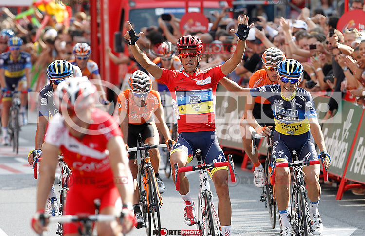 Alberto Contador celebrates with his partners the victory in La Vuelta when comes to the finish line in the stage of La Vuelta 2012 beetwen Cercedilla and Madrid.September 9,2012. (ALTERPHOTOS/Acero)