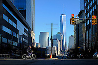 The New York's World Trade Center is seen at the background while a man rides his bicycle along a street during a sunny day in the Neighborhood of Exchange Place in New Jersey, 12/15/2015 Photo by VIEWpress
