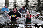 A look of relief is registered on Laura Boyle's L), face as she and Julia Harris (R) walk from the icy waters of the Burley Lagoon after participating in the 24th annual Polar Bear Jump in Olalla, Washington on January 1, 2008. Jim Bryant Photo. ©2010. ALL RIGHTS RESERVED.
