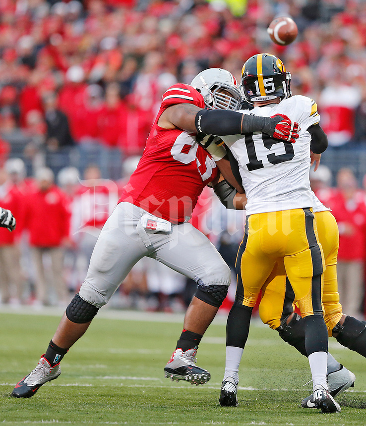 Ohio State Buckeyes defensive lineman Michael Bennett (63) pressures Iowa Hawkeyes quarterback Jake Rudock (15) at Ohio Stadium on October 19, 2013.  (Chris Russell/Dispatch Photo)