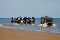 Holkham, Norfolk, England, 03/08/2009..The Royal Household Cavalry exercise their horses and take them swimming on Holkham beach.