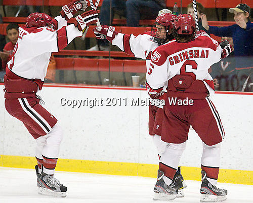 Patrick McNally (Harvard - 8), Rence Coassin (Harvard - 17), Ryan Grimshaw (Harvard - 6) - The Harvard University Crimson defeated the visiting Colgate University Raiders 4-2 on Saturday, November 12, 2011, at Bright Hockey Center in Cambridge, Massachusetts.