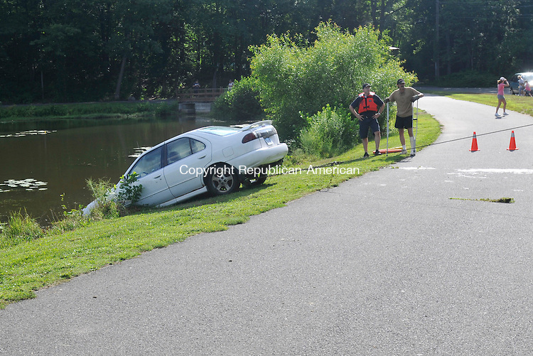 NAUGATUCK, CT-22 JULY 2010-072210IP08-  A car is pulled out of Baummer Pond in Naugatuck after it rolled without passengers from a driveway across the street and into the water. No one was injured.<br /> Irena Pastorello Republican-American