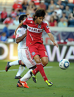 Chicago midfielder Sebastian Grazzini (10) shields the ball from Toronto midfielder Julian de Guzman (6).  The Chicago Fire defeated Toronto FC 2-0 at Toyota Park in Bridgeview, IL on August 21, 2011.