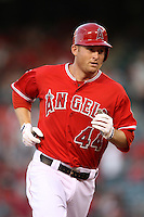 Mark Trumbo #44 of the Los Angeles Angels runs the bases against the Seattle Mariners at Angel Stadium on June 5, 2012 in Anaheim,California. Los Angeles defeated Seattle 6-1.(Larry Goren/Four Seam Images)