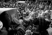 Northern Afghanistan<br /> October 2001<br /> <br /> After, American John Weaver distributes the last of Canadian donated oil for Shelter for Life and the World Food Program, a crowd follows him through the streets near the Nowabad refugee camp. .