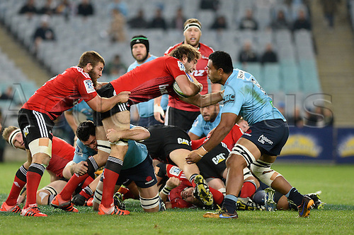 23.05.2015.  Sydney, Australia. Super Rugby. NSW Waratahs versus the Crusaders. Crusaders lock Samuel Whitelock is tackled by Waratahs no 8 Wycliff Palu. The Waratahs won 32-22.