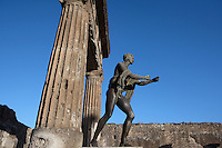 Apollo, statue, bronze, Temple of Apollo, Pompeii. The statue of Apollo as an archer was found in fragments and the original is in the National Archaeological Museum, Naples. The temple is located to the West of the Forum and was built in the 2nd century BC
