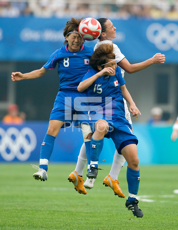 Japanese midfielders (8) Aya Miyama and (15) Mizuho Sakaguchi goes up for a header with New Zealand captain (8) Hayley Moorwood during first round play in the 2008 Beijing Olympics at Qinhuangdao, China. .  Japan tied New Zealand, 2-2, at Qinhuangdao Stadium.