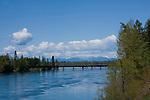Idaho, Clark Fork, Clark Fork River. Two Railroad bridges cross the Clark Fork River with Schweitzer Mountain Ski Resort in the distance.