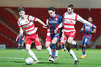 Alex Gilliead of Bradford City tries to get past Joe Wright and Matty Blair of Doncaster Rovers during the Sky Bet League 1 match between Doncaster Rovers and Bradford City at the Keepmoat Stadium, Doncaster, England on 19 March 2018. Photo by Thomas Gadd.