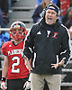 Plainedge varsity football head coach Rob Shaver calls out instructions to his team during a Nassau County Conference III game against Lawrence at Plainedge High School on Saturday, October 17, 2015. Plainedge won 38-0.<br /> <br /> James Escher