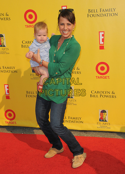 CONSTANCE ZIMMER & BABY .at The 2008 P.S. Arts' Express Yourself sponsored by Target held at Barker Hangar in Santa Monica, California, USA,  November 16th 2008.                                                                     .full length green top shirt jeans child daughter necklace brown suede mocasins .CAP/DVS.©Debbie VanStory/Capital Pictures