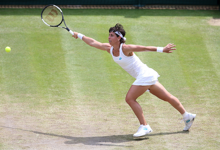 Carla Suarez Navarro (ESP) during her match against  Serena Williams (USA) in their Ladies' Singles Fourth Round match<br /> <br /> Photographer Rob Newell/CameraSport<br /> <br /> Wimbledon Lawn Tennis Championships - Day 7 - Monday 8th July 2019 -  All England Lawn Tennis and Croquet Club - Wimbledon - London - England<br /> <br /> World Copyright © 2019 CameraSport. All rights reserved. 43 Linden Ave. Countesthorpe. Leicester. England. LE8 5PG - Tel: +44 (0) 116 277 4147 - admin@camerasport.com - www.camerasport.com