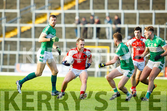 Donal O'Sullivan Rathmore takes on Chris Davies and Billy McGuire Legion during the East Kerry final on Sunday