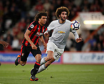 Nathan Ake of Bournemouth runs past Marouane Fellaini of Manchester United during the premier league match at the Vitality Stadium, Bournemouth. Picture date 18th April 2018. Picture credit should read: David Klein/Sportimage