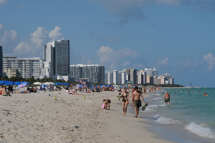 People enyoying the sun sand and warm ocean waters of beautiful South Beach, Miami Beach, Florida.