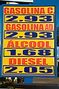 A fuel price list for ethnanol, compressed natural gas, diesel and 'gasoline C' which gasoline with ethanol added. Ciuaba, Mato Grosso, Brazil