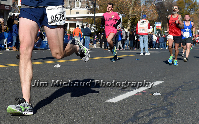 People coming into the finish line during the 81st running of the Manchester Road Race, Thursday, November 23, 2017, in  Manchester. (Jim Michaud / Journal Inquirer)
