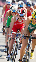 24 JUL 2014 - GLASGOW, GBR - Vicky Holland (ENG) (centre, in red and white) from England drafts Emma Moffatt (AUS) (right) of Australia on the bike during the elite women's 2014 Commonwealth Games triathlon in Strathclyde Country Park, in Glasgow, Scotland (PHOTO COPYRIGHT &copy; 2014 NIGEL FARROW, ALL RIGHTS RESERVED)<br /> *******************************<br /> COMMONWEALTH GAMES <br /> FEDERATION USAGE <br /> RULES APPLY<br /> *******************************