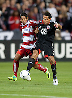 Dwayne De Rosario (7) of D.C. United shoots the ball while being defended by Carlos Rodriguez (22) of FC Dallas at RFK Stadium in Washington DC.   Dallas FC fell to D.C. United, 4-1.