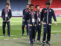 Hampden Park, Glasgow match venue for Football at London 2012...Japanese players leaving the pitch after inspecting it.........
