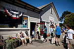 Cyclists and tourists queue up at the Bovine Bakery in Pt. Reyes Station, Calif., July 2, 2011.