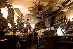 A giant metal reptile graces the ceiling of Mother's Revenge bar in Shimokitazawa, Setagaya Ward, Tokyo, Japan..Photographer: Robert Gilhooly