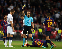Eric Dier of Tottenham Hotspur is booked after a tackle on Luis Suarez of FC Barcelona during Tottenham Hotspur vs FC Barcelona, UEFA Champions League Football at Wembley Stadium on 3rd October 2018
