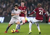 4th February 2019, London Stadium, London, England; EPL Premier League football, West Ham United versus Liverpool; Mohamed Salah of Liverpool takes on Angelo Ogbonna of West Ham United