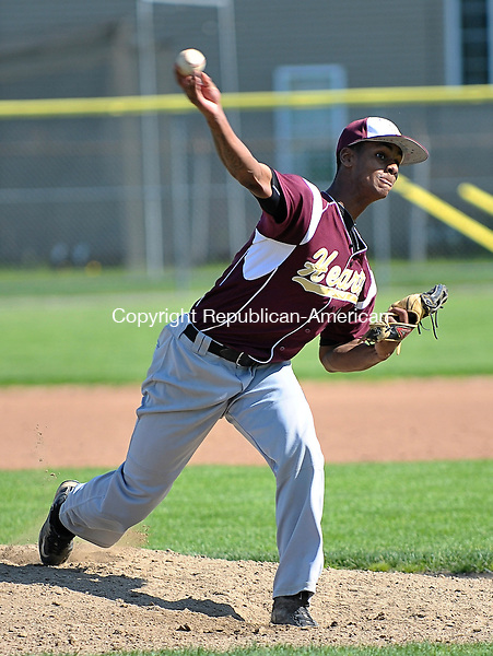 TORRINGTON, CT-18 May 2012-051812EC04-- Sacred Heart's pitcher Dwayne (DJ) Ellis throws against Torrington at Fuessenich Park Friday afternoon. The Red Raiders beat the Hearts 11-3, winning the NVL Copper title.  Erin Covey Republican-American