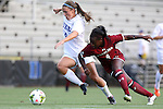 14 August 2014: Duke's Morgan Reis (left) and South Carolina's Raina Johnson (right). The Duke University Blue Devils hosted the University of South Carolina Gamecocks at Koskinen Stadium in Durham, NC in a 2014 NCAA Division I Women's Soccer preseason match. Duke won the exhibition 2-0.