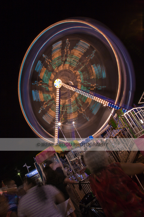 ISO 200 and an aperture of f/20 were just the right combination to give a shutter speed of 4.0 sec. This slower shutter speed meant that the camera captured this ferris wheel at the 2007 Montgomery County Agricultural Fair as it revolved, resulting in the blur of color shown here. The effect also gives the impression that the ride is spinning very fast, whereas it was actually moving quite slowly.