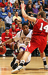 SIOUX FALLS, SD - MARCH 9:  Jordan Foster #10 from Western Illinois drives against Casey Kasperbauer #14 from the University of South Dakota in the first half of their quarterfinal game Saturday evening at the 2013 Summit League Basketball Tournament in Sioux Falls, SD.  (Photo by Dave Eggen/Inertia)