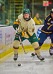 29 December 2013:  University of Vermont Catamount Forward Jonathan Turk, a Sophomore from Calgary, Alberta, in first period action against the Canisius College Golden Griffins at Gutterson Fieldhouse in Burlington, Vermont. The Catamounts defeated the Golden Griffins 6-2 to capture the 2013 Sheraton/TD Bank Catamount Cup NCAA Hockey Tournament for the second straight year. Mandatory Credit: Ed Wolfstein Photo *** RAW (NEF) Image File Available ***