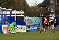 Dan Bennett of Kingstonian scores the third during Macclesfield Town vs Kingstonian, Emirates FA Cup Football at the Moss Rose Stadium on 10th November 2019