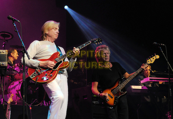 THE MOODY BLUES.Musicians Justin Hayward & John Lodge of The Moody Blues performs onstage at Hamilton Place during the 2010 Tour, Hamilton, Ontario, Canada..July 5th, 2010.stage concert live gig performance music half length white top full 3/4 guitar bass black profile.CAP/ADM/BPC.©Brent Perniac/AdMedia/Capital Pictures.