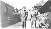 Two gentlemen posing at the Placerville depot.  Outfit bunk car #01564 which was destroyed by fire November 19, 1920 is alongside the station platform.<br /> RGS  Placerville, CO  ca. 1910-1920