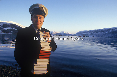 Ullapool Scotland. 1986. Local resident Vincent Jenkins with bibles for the Bulgarian factory fishermen.