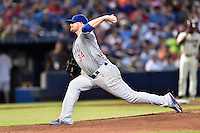 Chicago Cubs starting pitcher Jon Lester (34) delivers a pitch during a game against the Atlanta Braves on July 18, 2015 in Atlanta, Georgia. The Cubs defeated the Braves 4-0. (Tony Farlow/Four Seam Images)