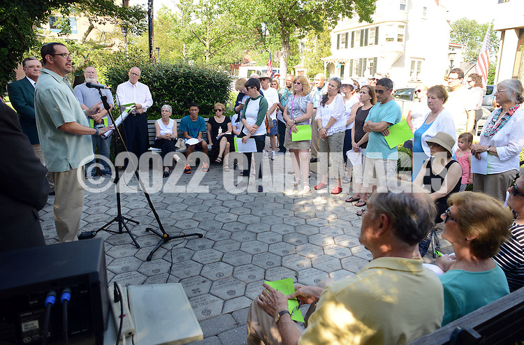 Rabbi Mitch Delcau of Temple Judea speaks during an interfaith prayer vigil at the Bucks County Courthousein memory of the victims of the South Carolina shooting Monday June 22, 2015 in Doylestown, Pennsylvania. (Photo by William Thomas Cain)