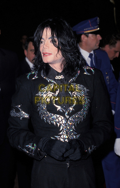 MICHAEL JACKSON.The World Music Awards,.Monte Carlo, 10th May 2000.half length black trousers gloves eye contact jacket silver metallic dragon serpent chinese japanese design hands together.www.capitalpictures.com.sales@capitalpictures.com.©Capital Pictures